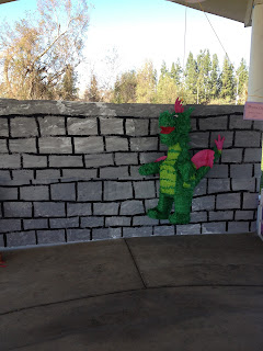 princess party with dragon pinata