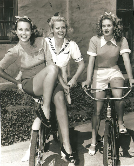Vintage Photos of Ladies with Bicycles.