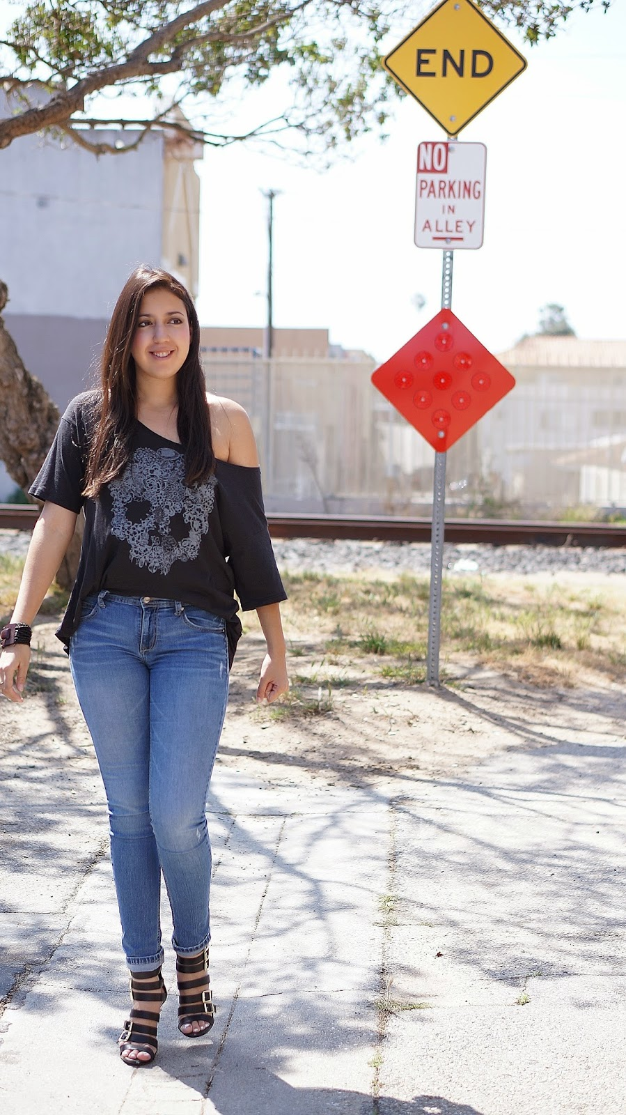 Fashion blogger, Latina Fashion blogger, casual outfit, Mossimo Saphire Strappy heels, Target heels, Off the shoulder top, skull shirt, free spirit, railroad tracks