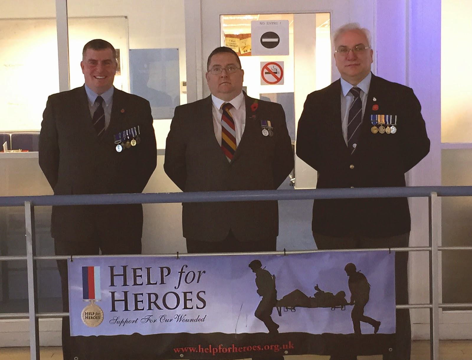 WW1 Centerprise Staff Wear Medals for Centennial in the Atrium, Basingstoke