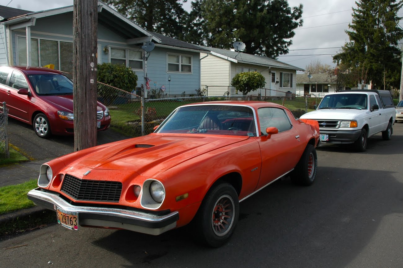 OLD PARKED CARS.: 1975 Chevy Camaro.