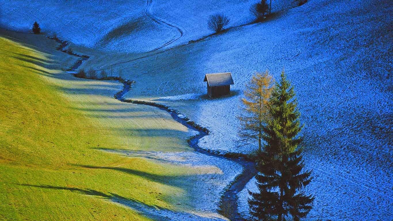 Sun defrosts half a meadow in Tulfes, Austria (© F1 Online/REX) 562