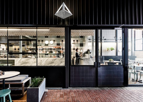 an industrial interior in concrete and steal patch cafe melbourne - Concrete Cafe Interior