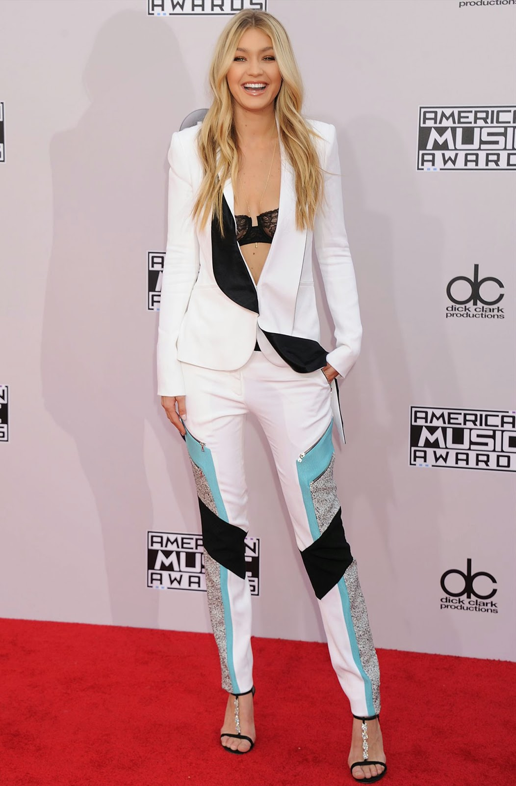 Gigi Hadid shows off lace bra in a Prabal Gurung pantsuit at the 2014 American Music Awards