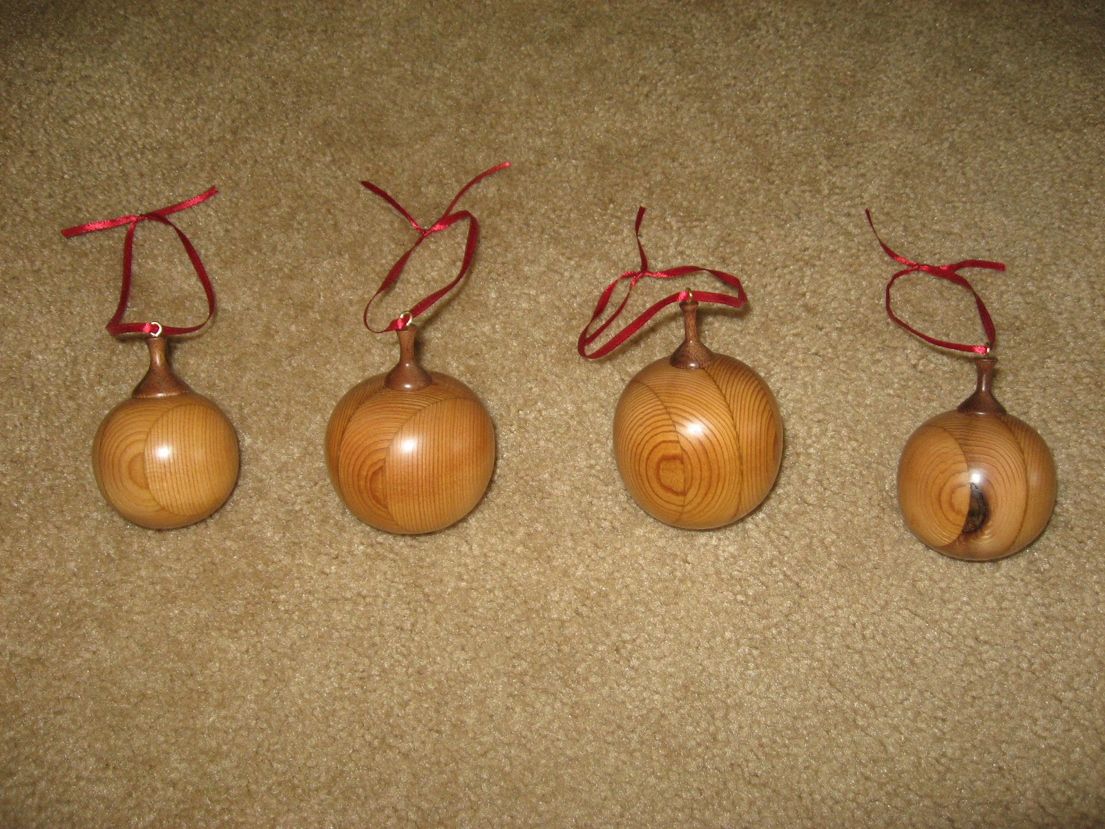 woodturning christmas ornaments. christmas balls redwood with walnut tops woodturning ornaments