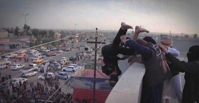 Militants of the Islamic State throw a young man off a roof in Nineveh for being gay. File photo