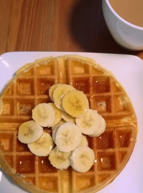 Belgium waffle with maple syrup and bananas