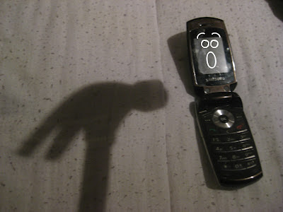 Phone fallen and screaming at a hammer's shadow