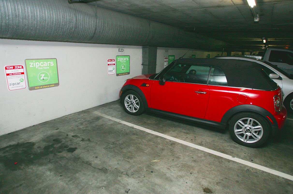 A typical ZipCar location in a dimly