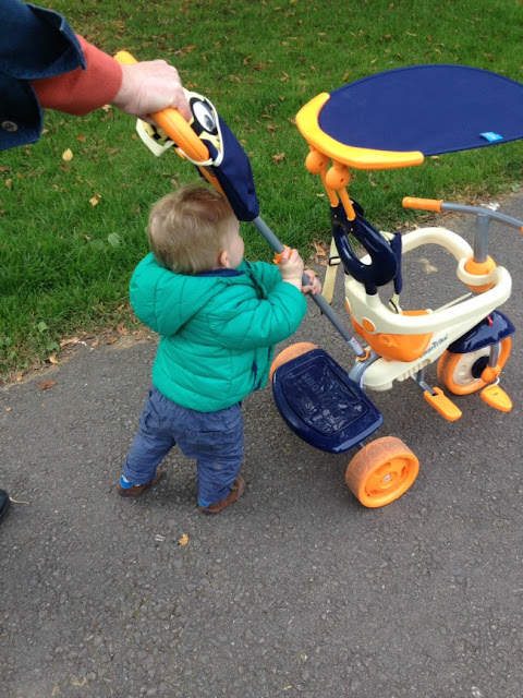 toddler pushing trike