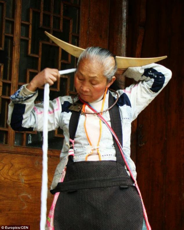 Miao lady preparing hair dress