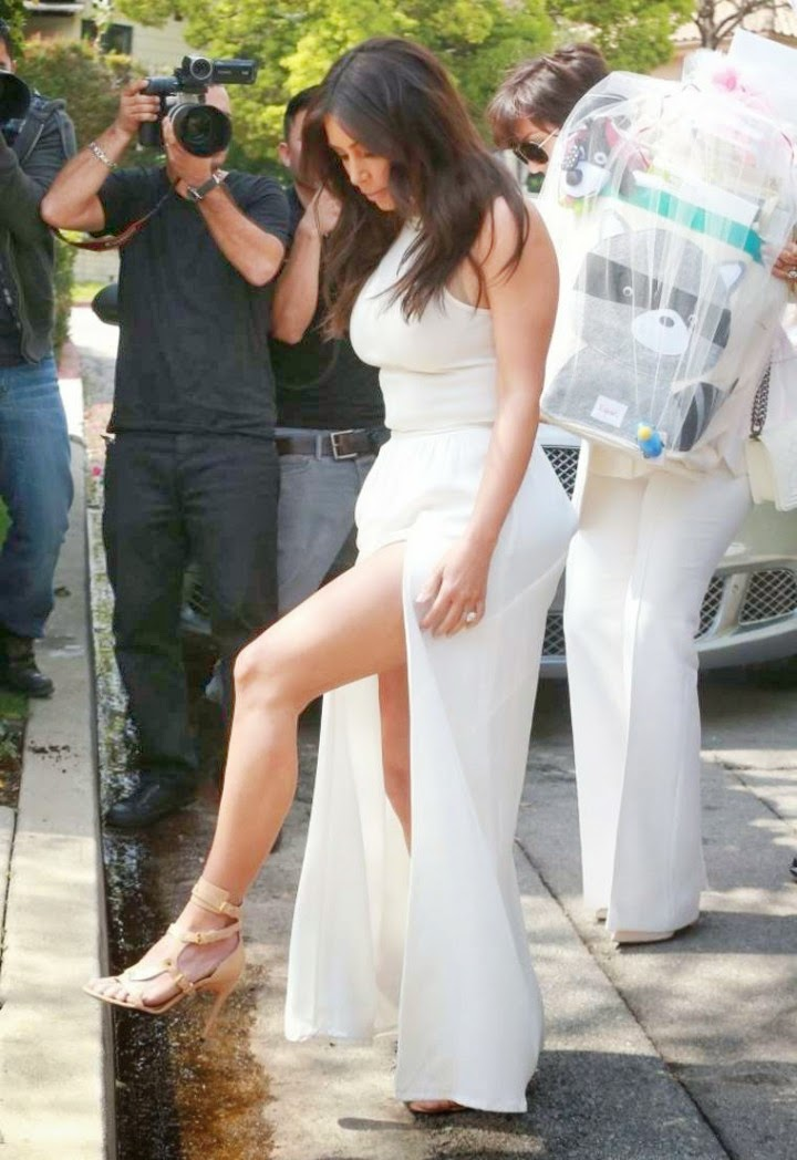 Kim Kardashian Arrives At Ciarau0027s Baby Shower In A White Cropped Top And  Maxi Skirt