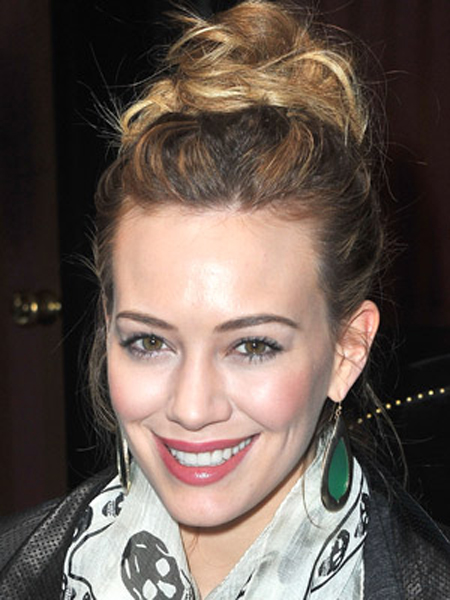 Hilary Duff keeps things casual with a loose and slightly unkempt updo
