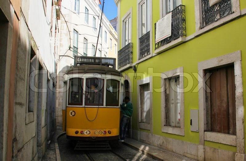 http://2.bp.blogspot.com/-SDWUK2tkrRw/VSV7vJJ1fII/AAAAAAAABUY/vzrqhqxWPXE/s1600/3276051-tram-car-tram-electric-car-narrow-street-narrow-alley-portugal-2012-lisboa-lisbon-lissabon-lisbonne-lisbona.jpg