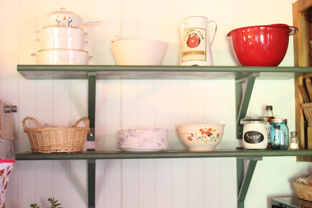 Shelves made from stair treads and Ikea brackets.  Part of Cabin Kitchen Makeover vis www.goldenboysandme.com