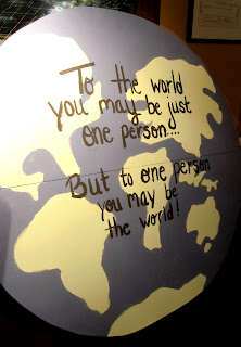 "A globe with the saying ""To one person, you may be the world!""  Photo by Patricia Stimac"