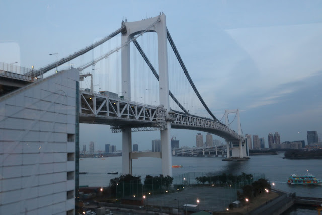 Crossing the popular Rainbow Bridge during the ride on the Yurikamome rapid transit line which connects the Tokyo central and Tokyo Bay artificial island in Japan