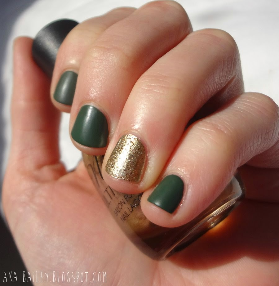 Matte green nails with sparkling gold accent nails