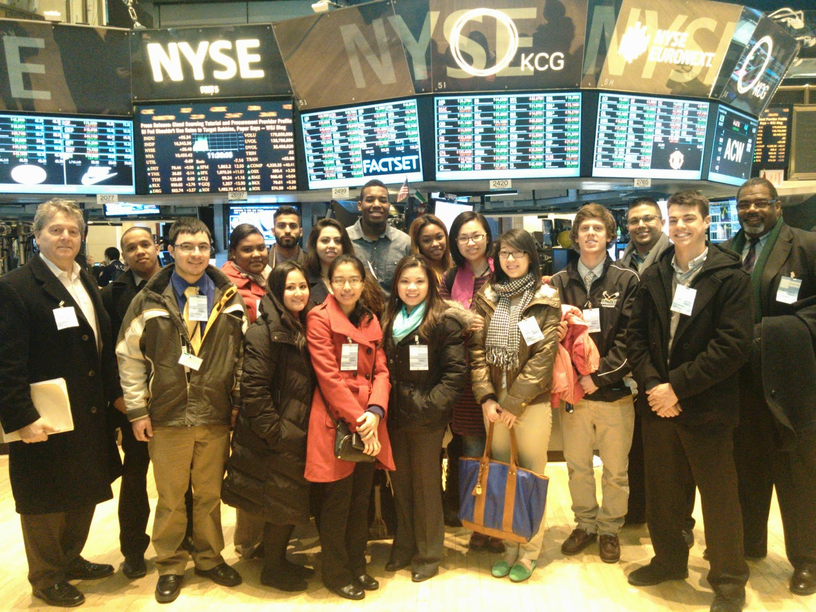 Group of students and professors on the floor of the New York Stock Exchange.