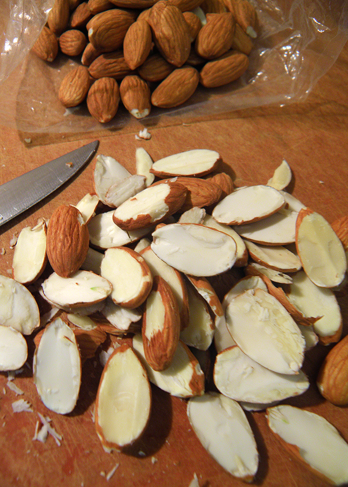 Almonds and Knife on Cutting Board