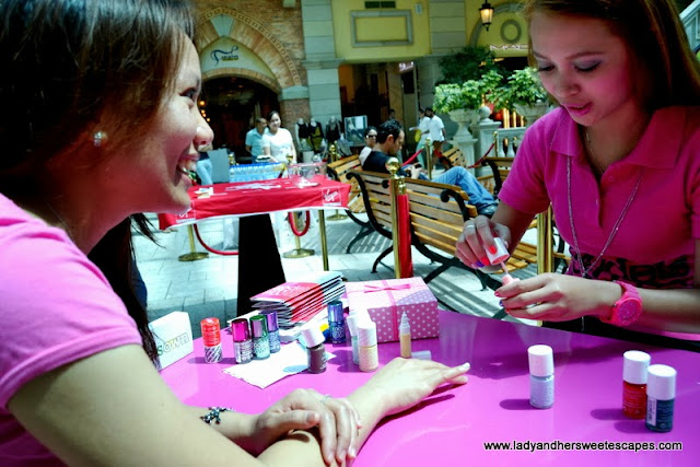 my friend during her free manicure session Models Own booth