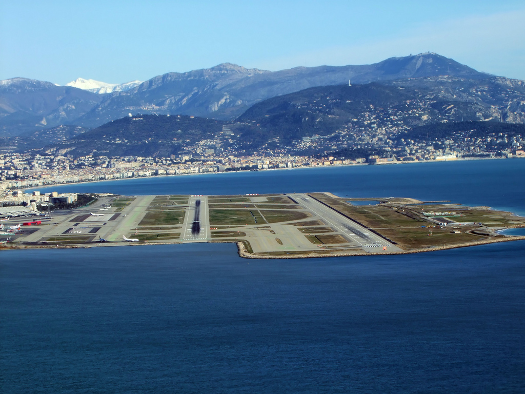 The runways of Nice's airport are built on reclaimed land on what feels like ...