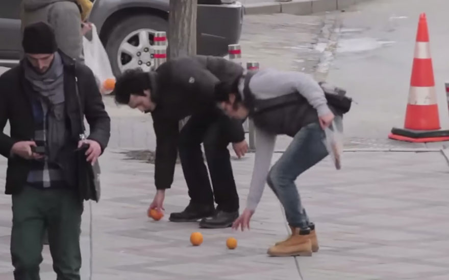 Entire Neighbourhood Secretly Learns Sign Language To Surprise Deaf Neighbor - This man at the grocer's dropped his oranges and when Muharrem and Ozlem picked them up for him…
