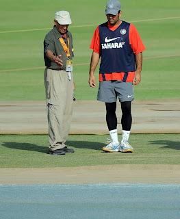 Indian skipper Dhoni and curator inspect the Mohali pitch