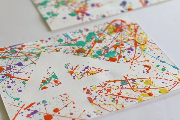 http://buggyandbuddy.com/easy-art-projects-kids-splatter-paint-tape-resist/