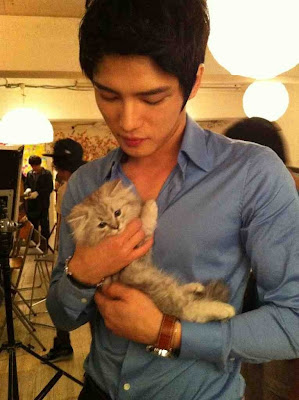 actor holding kitten
