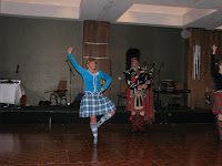 Piper and Scottish Dancer at Ceilidh 2012