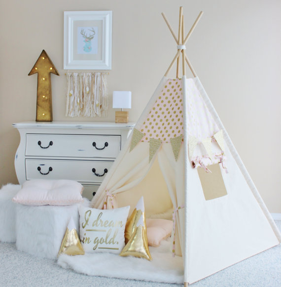 baby girl nursery with teepee