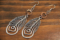 Brushed Metal Feather and Copper Gear Earrings by hotGlued