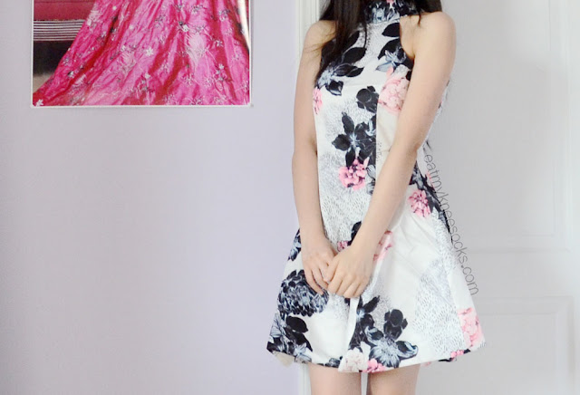 Spice up your summer and spring wardrobe with a flirty flared floral dress, like Romwe's halterneck dress.