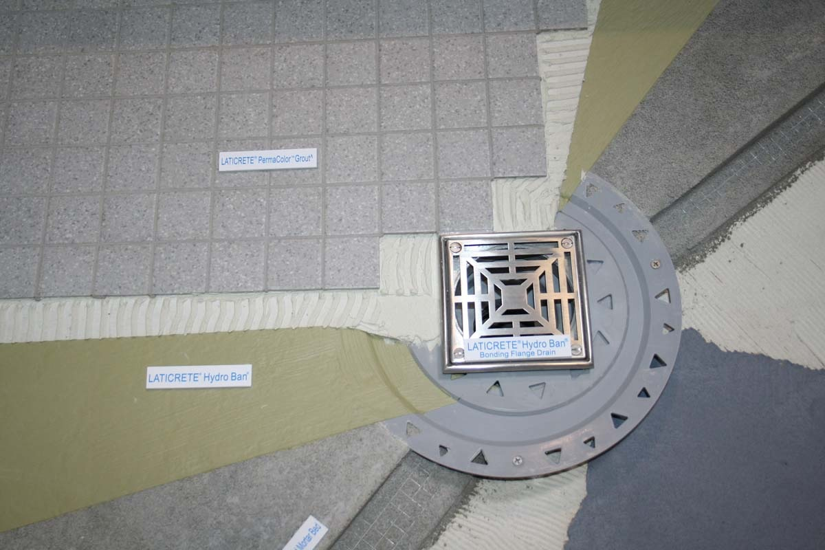 Water That Makes It Through The Tile To The Green Barrier Will Make Itu0027s  Way To The Drain And From There, Thereu0027s Holes That Allow It To Get Into  The Drain.