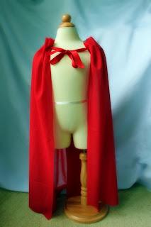 http://www.littlepinkmonster.com/2011/08/09/no-sew-superhero-cape/