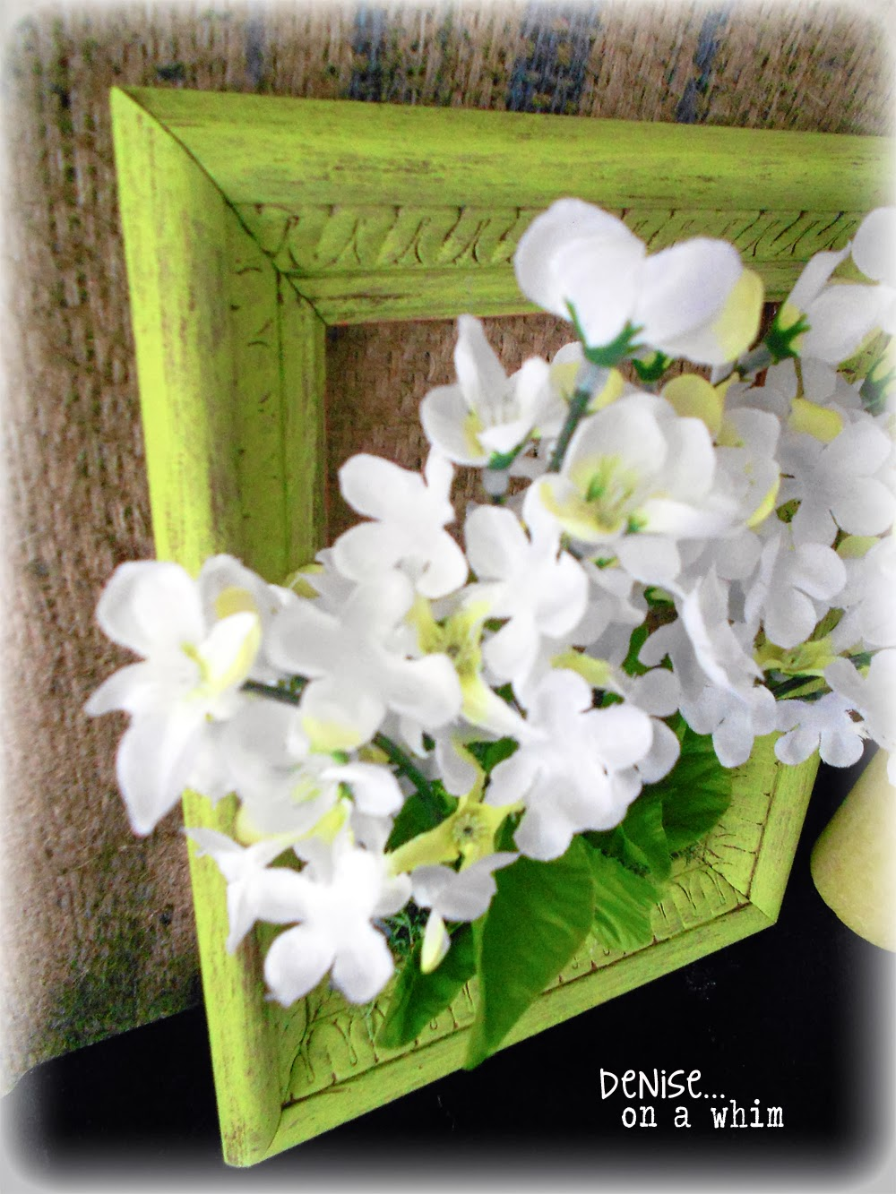 Dollar store flowers look so pretty in this spring frame via http://deniseonawhim.blogspot.com