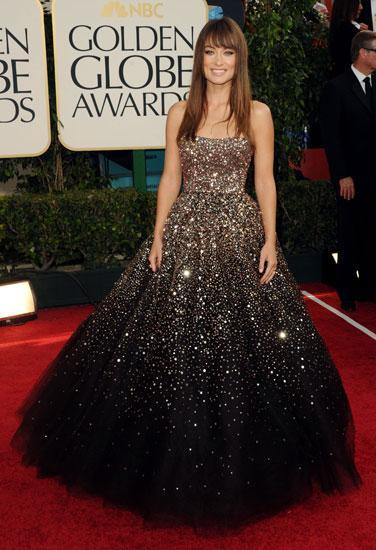Realmente um vestido de princesa, colorido,com bastante brilho, eu to