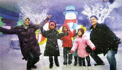 Happy Family in i-City SnoWalk enjoying some fun snow!