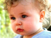 Cute Little Baby Boy With Blue Eyes HD Wallpaper is a Beautiful Wallpaper .