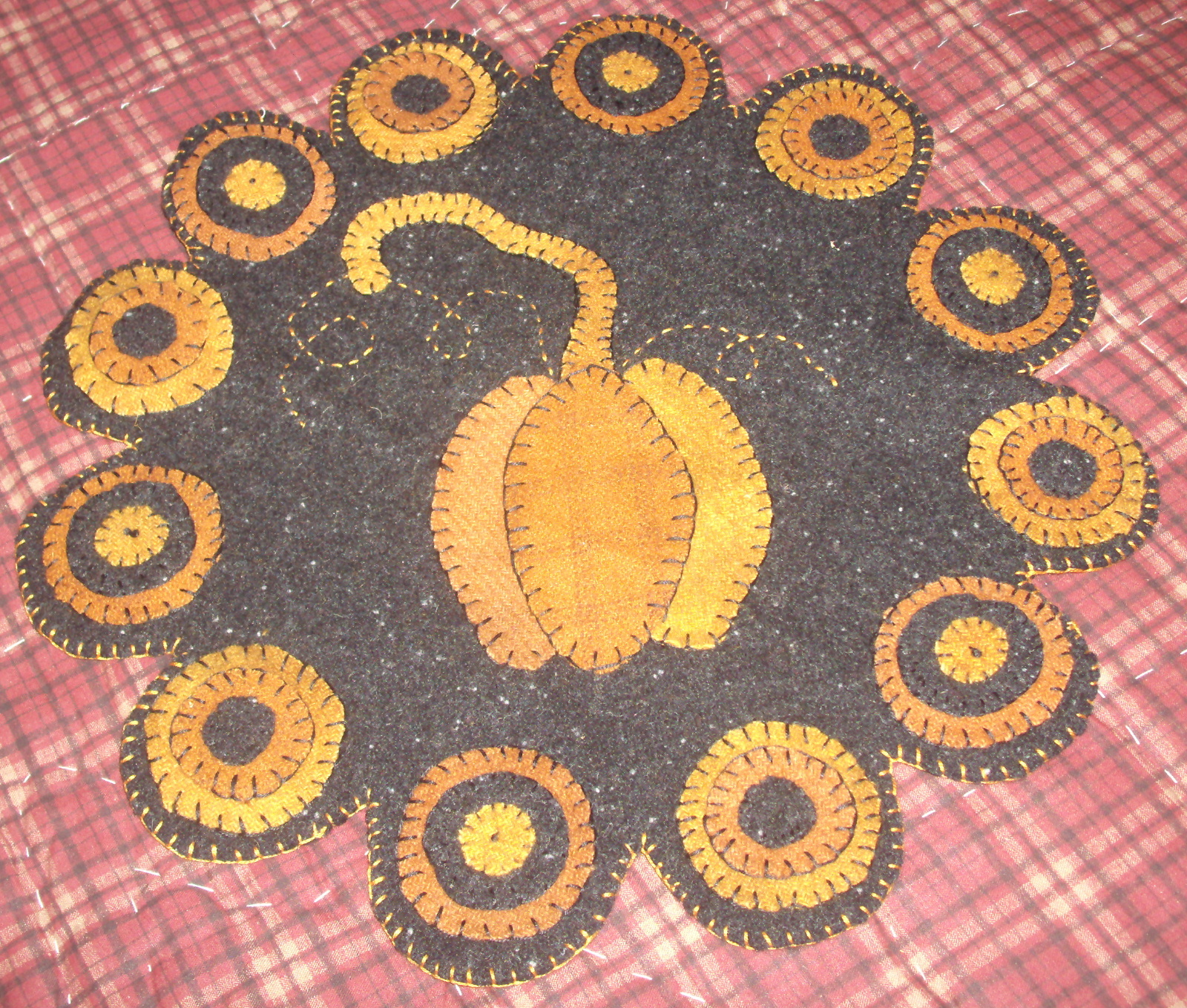 my very first penny rug completed