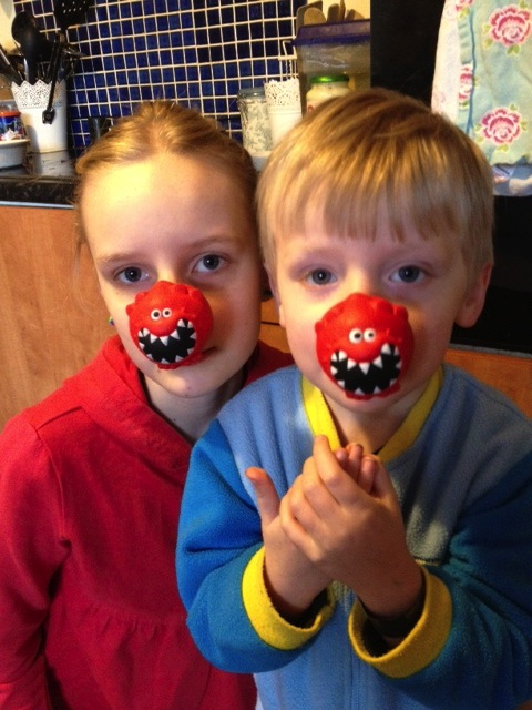children wearing red noses for Comic Relief