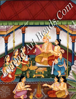 Emperor Dasaratba worships the gods to get a son, and as a result received four divine sons as incarnations of the god Vishnu. The picture shows the king, aided by his royal priest Vasistha, presiding over a ceremony to bless his newly-born sons, Rama, Bharata, Lakshmana and Satrughna, held in the arms of their mothen,, Kausalya, Kaikeyi and Sumitra. Meanwhile &mantra, the minister, reads from the hymns of the Vedas and in the foreground priests pour grains and ghee into the sacred fire.