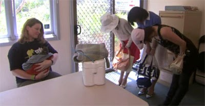 The girls bow to the Sydney Wildlife Rescue staff member who found the baby kangaroo.