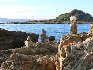 Rock cairns at Island Bay ©2014 Tina M Welter
