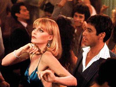 Al Pacino as Tony Montana, Michelle Pfeiffer as the mobster's moll Elvira Hancock, Scarface, Directed by  Brian De Palma