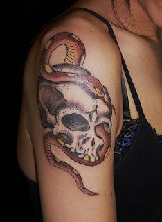 skull tattoo / snake tattoo