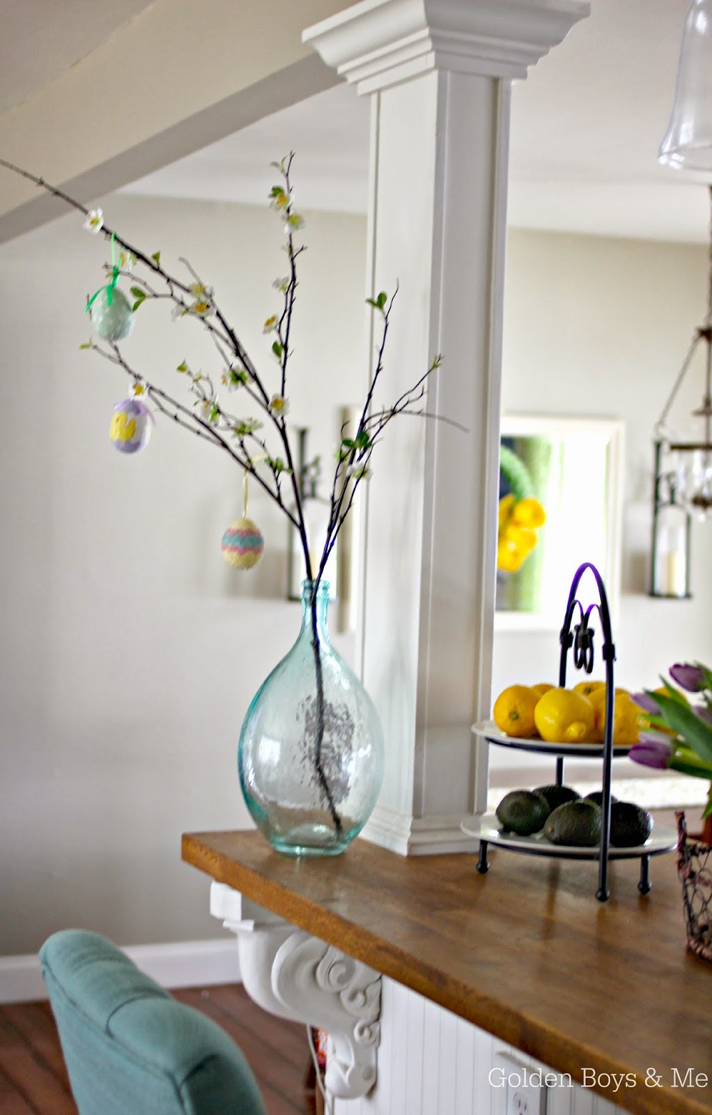 Easter egg tree in green glass vase || www.goldenboysandme.com