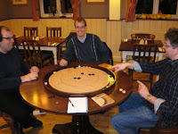 Crokinole - The players enjoying the game