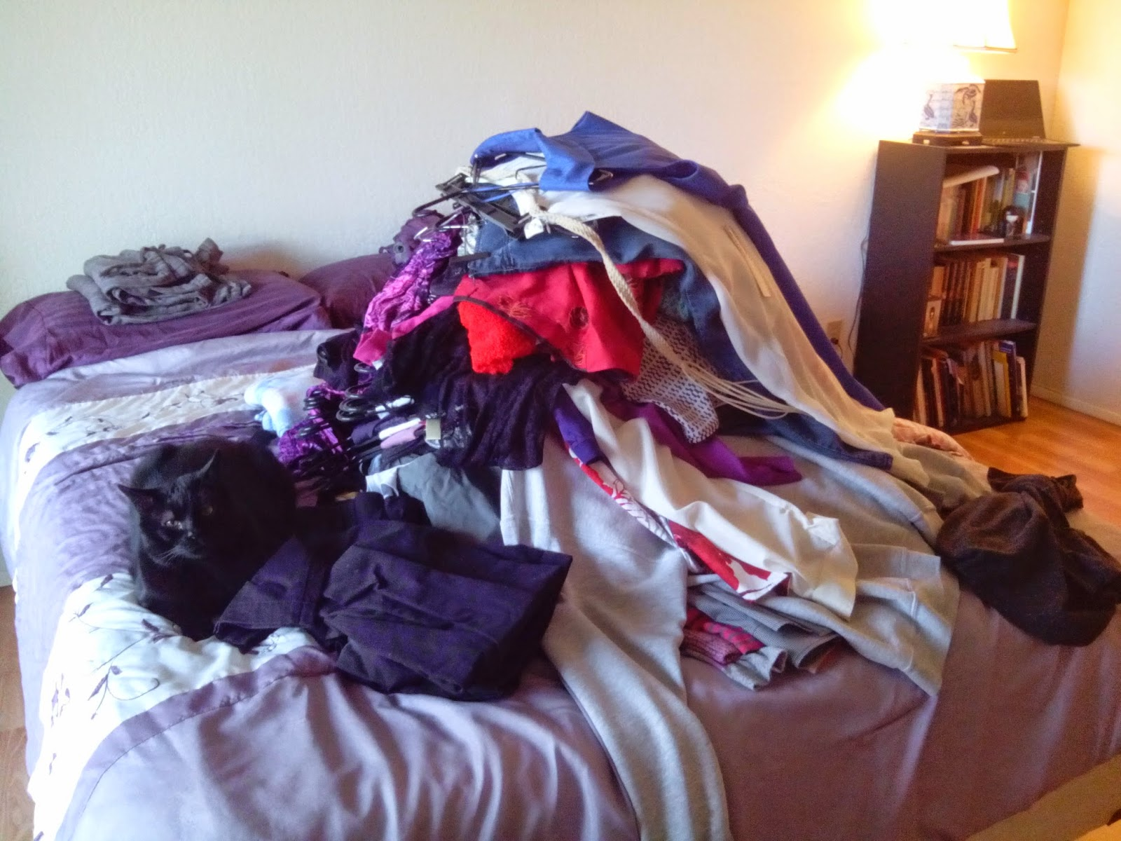 Image result for pile of clothes on the bed